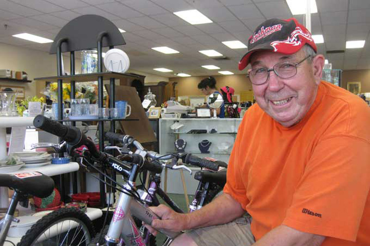 Photo shows that one of the ways to volunterr at Nu2u is to refurbish bicycles.
