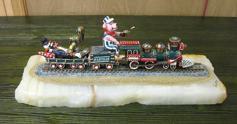 Ron Lee circus clowns train called 'Hamtrack' with a pink piggie as engineer.