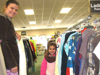 A smiling mom and her daughter in the women's clothes section of Nu2u Resale shop in Tinley Park.